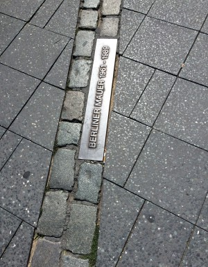 A double row of cobblestones runs through the city, marking the location of the wall.