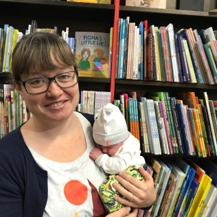 Baby's first book store visit! Two weeks old.